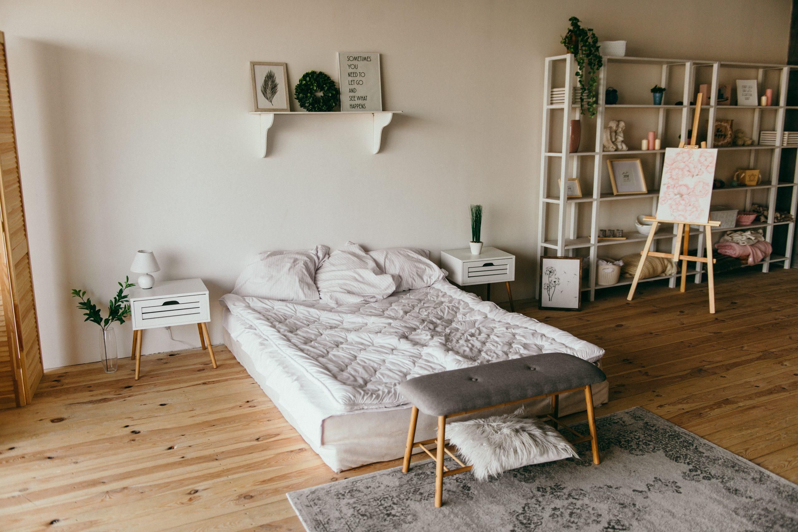 white-wooden-shelf-beside-bed-2062431
